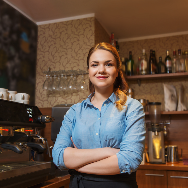 Barista smiling in coffee shop