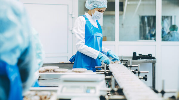 Food manufacturing employee in a factory