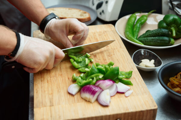 Chef preparing Vegetables wearing gloves