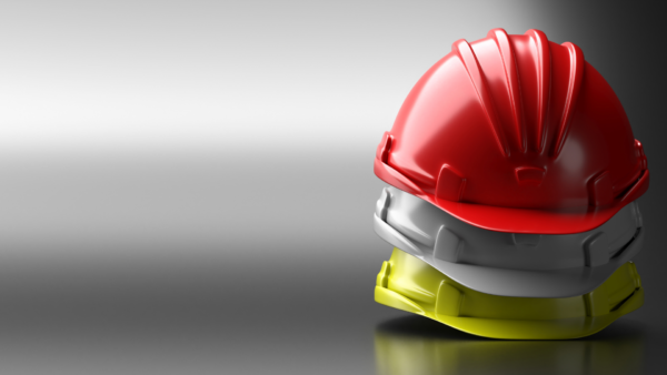 Three different coloured construction hats