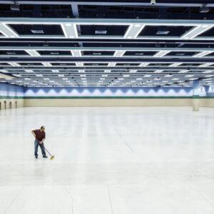 Lone worker sweeping floor