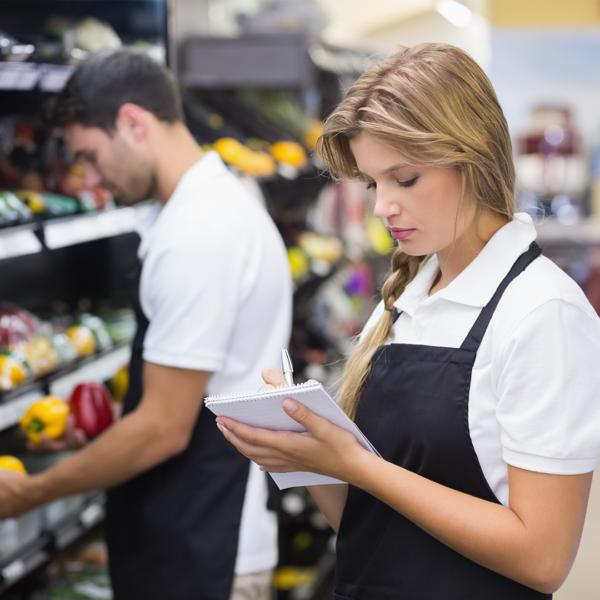 Shop staff stock-taking fruit and veg