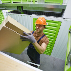 Worker placing box on a shelf