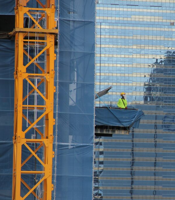 Construction worker on external lift