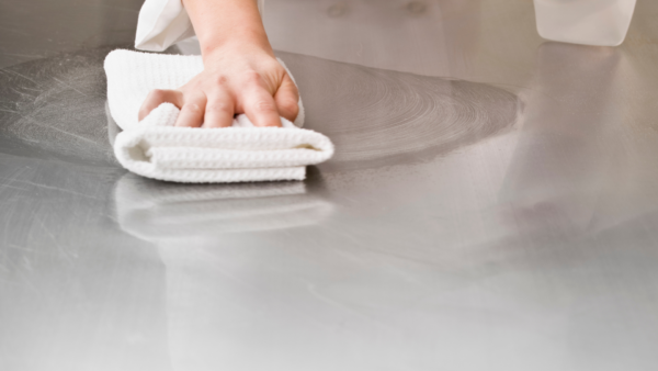 Kitchen Staff wiping down surfaces