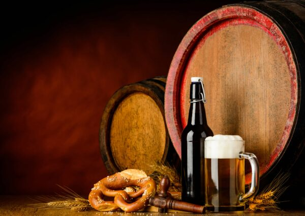 Beer barrel, pretzel, and pint of beer